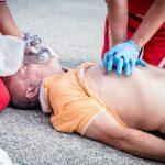 Paramedics succor a man with heart attack - Stock Image